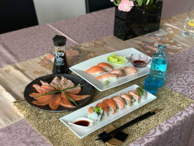 Sashimi, nigiri and inside-out roll sushi