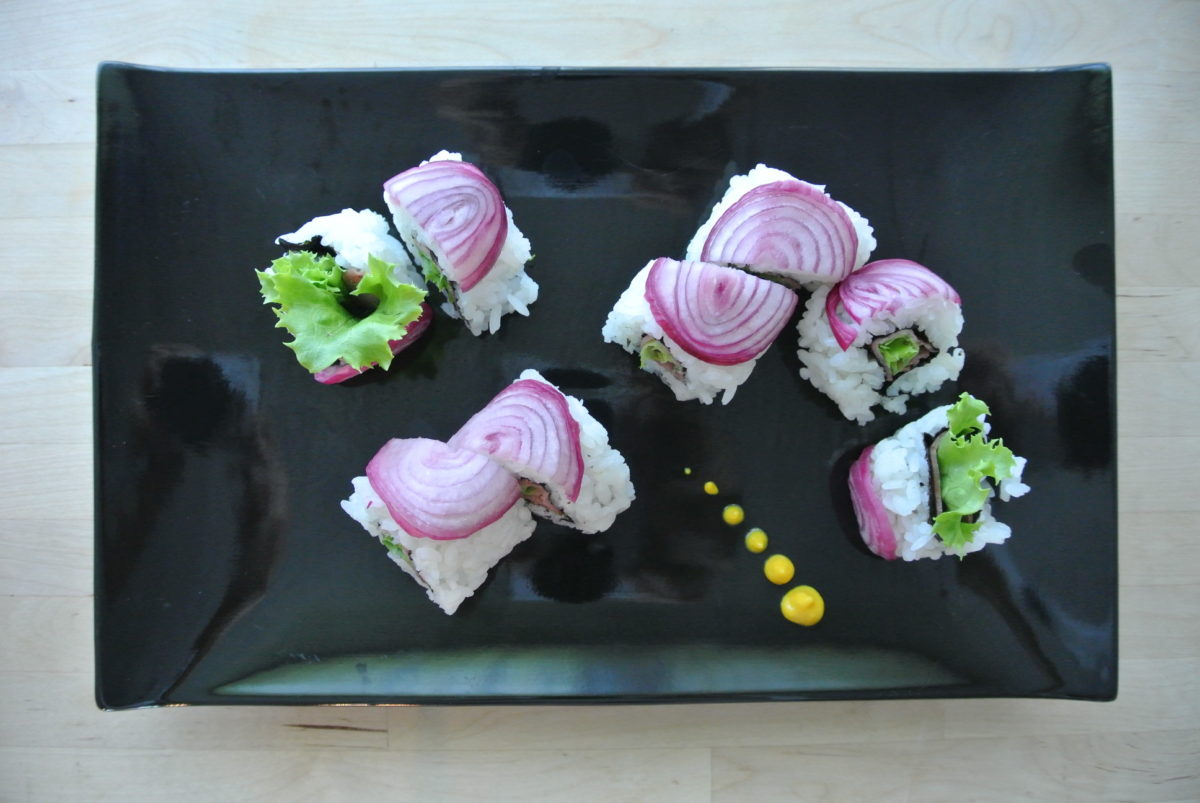 inside out roll sushi with red onion