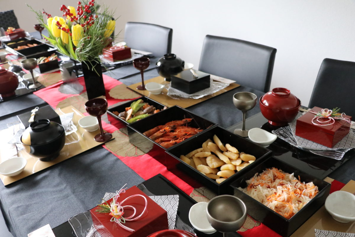 New Year's party with traditional Japanese new year foods (Osechi)